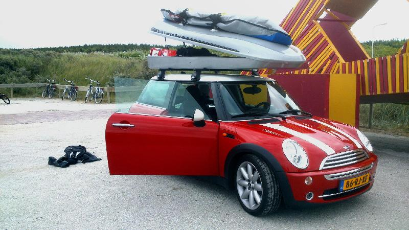 A Mini Cooper with a Surfboard Rack